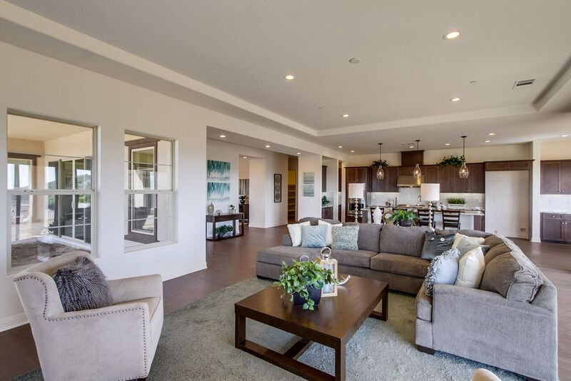Kitchen and living room staging with beige and grey accents