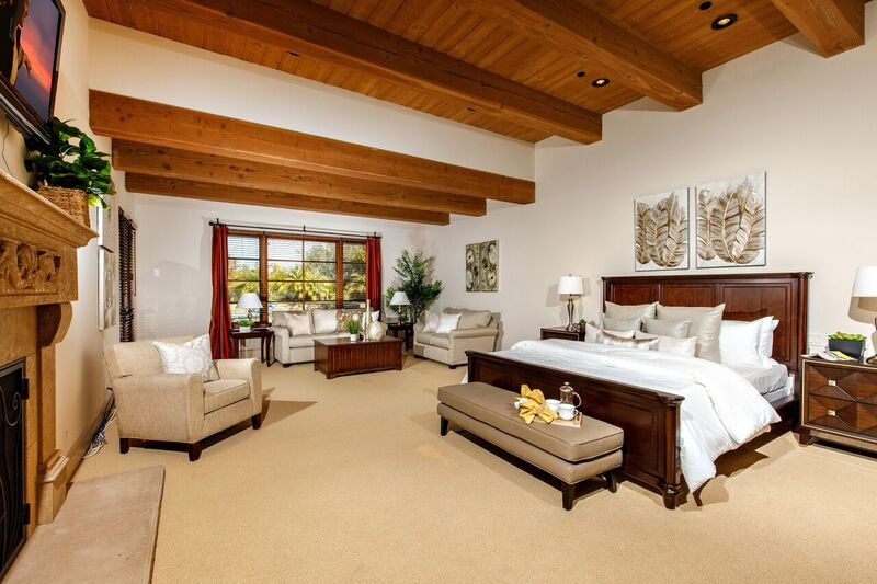 Bedroom staging with wooden accents