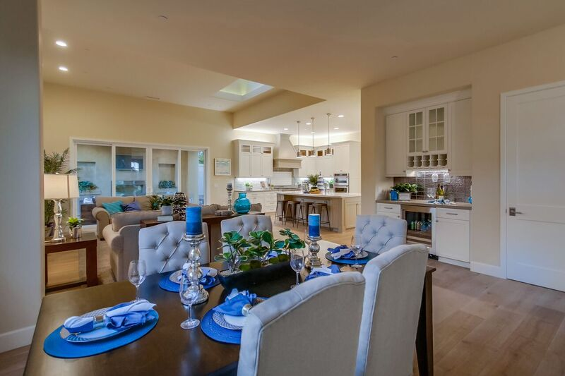 Kitchen, dining room and living room staging with cream and blue accents